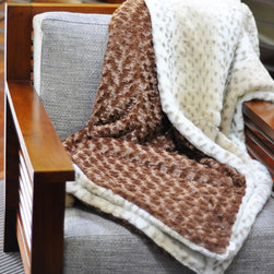 Snow Leopard and Mocha Throw - This faux throw blanket is supremely soft and cozy with an exotic twist. With a luxurious feel and touch, this throw is the perfect addition to your home that will add both comfort and style. Perfect for draping across the sofa, or at the edge of the bed, this throw will make you feel like royalty as you rest!