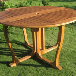 International Caravan - Outdoor Round Dining Table - All weather resistant. UV light fading protective coating. Plenty of space. Premium dual stain finish. Made from pure yellow balau hardwood. Made in Vietnam. Assembly required. 51.5 in. Dia. x 29 in. H (65 lbs.)