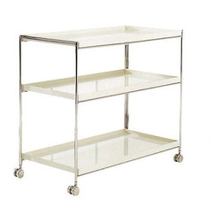 "Kartell - Trays Serving Cart - Minimalist, geometric and highly functional, the Trays Trolley is inspired by the polished surfaces and simple elegance of lacquered Japanese trays. The three superimposed shelves are made of solid, refined methacrylate with a support structure of sturdy, chrome-plated steel, creating an effect of lightness and refinement without any compromise in strength or stability. With caster wheels for easy mobility, this trolley is perfect for a number of uses, such as saving space for toiletries in compact bathrooms or bringing teatime staples out of the kitchen on a relaxed afternoon. Designed by: Piero Lissoni, 2002 Features at a Glance: Trays Trolley Features: -Frame made of chrome-plated steel. -Shelves made of batch-dyed PMMA. -Structure set on caster wheels. -Made in Italy. -Overall dimensions: 28.66"" H x 32"" W x 16"" D. Quality: -In 2005, Kartell received accreditation for its Quality Management Systems according to the ISO 9001: 2000 standard. The attainment and preservation of this certification testifies to Kartell's commitment to high quality and continued research into higher levels of quality in company management systems.. Helping the Environment: -Kartell products use a wide variety of plastic materials, thereby reducing the use of living organisms, such as trees, which are difficult and time-consuming to replace.. -Most Kartell products are easily recycled and product components can be separated to elements made of a single material to simplify the recycling process. Plastic components also carry clear identification marks to aid correct separation of different plastic types for effective recycling.. Care and Maintenance: -Kartell products are easy to clean and require only simple care to remain in excellent condition. Please see here for specific information on the proper cleaning and use of Kartell materials.. Order with Confidence: -Authentic Kartell products are guaranteed to be free from defects in materials and workmanship for a period of 12 months under normal use and under conditions for which the items were designated.. -Should you discover shortly after receiving your Trays Table that parts are either damaged or missing, please call us immediately, and we will be happy to send you replacement parts as soon as possible and at no additional cost.."