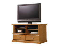 Sauder - Sauder Orchard Hills TV Stand in Carolina Oak Finish - Sauder - TV Stands - 401268 -Display your plasma, LCD, or other flat screen television on the sturdy Carolina Oak Wood TV Stand and complement your traditionally-inspired living room or media room. Enhance the relaxing ambiance of your space with the hearty oak finish of this classic TV stand from Sauder.