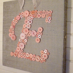 Baby Girl Button Monogram by Letter Perfect Designs - No nursery is complete without a monogram, and ones made with buttons are especially feminine. Although I made my own monogram for my girl's nursery (with a whopping 3 buttons on it), I've always admired this one and the patience it must take to make it.