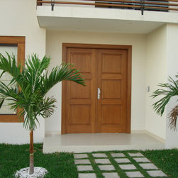 Solid Wood Entry Doors - Solid wood entry doors made out of Bolivian mahogany wood finished in a butternut color for a home in Barbados in the Caribbean Islands.