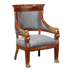 Consigned Period Empire Chair - Add something truly special to your favorite formal space. This grand mahogany Empire chair features detailed dragon carvings on the arms, gilt paw feet and touches of ormolu — a stately and important piece for your antiques collection.