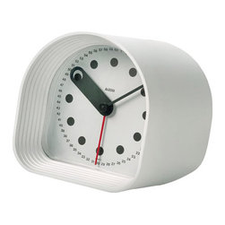 Alessi Optic Table Alarm Clock - hivemodern.com - Originally designed by Joe Colombo for Alessi in 1970, this compact modern clock has stood the test of time. The hours are simple dots, but the seconds are numbered 1-60 around the dial. My favorite detail? The little hole in the hour hand that covers the dot on the hour.