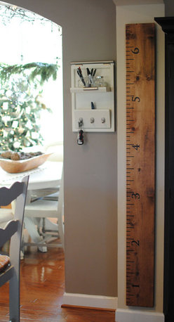 Oversized Ruler Growth Chart - This is my favorite growth chart find of all. You personalize it by adding the child's name and the heights of family members. Takes the fun out of doing the 'back-to-back-gee-whiz-Grandpa-I-think-I'm-taller-than-you' game at family get togethers, but is a fabulous keepsake. Not to mention it's modern design looks great on a wall.