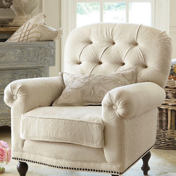 Provence Matelassa Chair - Lovely in a bedroom or beside the hearth, our consummately comfy armchair warms a room and invites hours of relaxation with a deeply tufted back, rolled arms and sumptuous, down-wrapped cushion. Built atop a solid birch frame and accented with antiqued brass nailhead trim, this timeless piece blends beautifully with many types of décor.