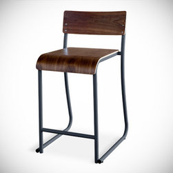 Gus* - Church Counterstool - Church Counterstool  by Gus Modern    At A Glance:   This stackable counterstool has a waterfall edge for your sitting comfort and powder-coated metal with plywood construction to look good anywhere. Frame is available in a slate or white powder coat. Wood finish is available in oak or walnut veneer.  What's To Like:  A stacking stool with gorgeous wood veneer, that looks like it's intended as a permanent fixture of the dining room? Sounds like a winner.Equally at home in a modern space as it is in a more eclectic home, the Church Counterstool is adaptable to your decor, whatever the style.Powder-coated steel frame will stand up to all the abuse you'll be (unintentionally) subjecting this counter stool to.  What's Not to Like:   For some, the metal frame's juxtaposition of angular and curved lines may be a stylistic miss. For others, that same mixture may be a hit. You know what they say about the eye of the beholder.