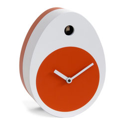 Progetti - Ocoque 1975 Table Clock - Ironic and curious is O'Coque, unconventional cuckoo egg shaped ... soft-boiled. Soft and sinuous shape characterized by the typical white and orange, is balanced on desk, on a shelf, on the library or you can hang it to liven up a wall; the bird at the top, marks the passing of the hours. o'Coque is included in the permanent exhibition of the Deutsches Uhrenmuseum, historical German Clock Museum, which is important for its large collection of clocks and cuckoo from all over the world. Cuckoo clock made in wood. Battery quartz movements. The Cuckoo strike is switched off automatically during the night controlled by a light sensor.