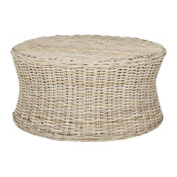 Safavieh - Ruxton Cocktail Ottoman - Bring the outdoors in with the woven rattan Ruxton cocktail ottoman, a transitional design that adapts to any decorating style from traditional to contemporary. With its low profile concave form and natural organic tone, Ruxton can be styled as a coffee table or cleared for use as extra seating or a footrest.