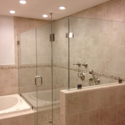 Frameless Shower Enclosure with 90 degree return - fully frameless shower enclosure, using starphire low iron glass.  installed using glass clamps.