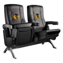 Dreamseat Inc. - Chicago Blackhawks NHL Row One VIP Theater Seat - Double - Check out these fantastic home theater chairs. These are the same seats that are in the owner's VIP luxury boxes at the big stadiums. It has a rocker back and padded seat, so it's unbelievably comfortable - once you're in it, you won't want to get up. Features a zip-in-zip-out logo panel embroidered with 70,000 stitches. Converts from a solid color to custom-logo furniture in seconds - perfect for a shared or multi-purpose room. Root for several teams? Simply swap the panels out when the seasons change. This is a true statement piece that is perfect for your Man Cave, Game Room, basement or garage.