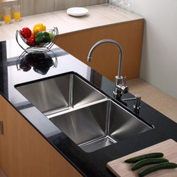 Kraus - Kraus KHU102-33-KPF2160-SD20 Double Basin Undermount Kitchen Sink with Faucet Mu - Shop for Kitchen from Hayneedle.com! Simple in style the Kraus KHU102-33-KPF2160-SD20 Double Basin Undermount Kitchen Sink with Faucet comes ready to take on any task your kitchen can dish out. The arching faucet smoothly operates with a single handle while an integrated soap dispenser is always at the ready. You can trust in the stainless steel construction to last for years and years against corrosion.Product SpecificationsNumber of Basins: 2Bowl Depth (inches): 10Weight (pounds): 35Low Lead Compliant: YesEco Friendly: YesMade in the USA: YesHandle Style: LeverValve Type: Ceramic DiscFlow Rate (GPM): 2.2Spout Height (inches): 9Spout Reach (inches): 7.5About KrausWhen you shop Kraus you'll find a unique selection of designer pieces including vessel sinks and faucet combinations. Kraus incorporates its distinguished style with superior functionality and affordability while maintaining highest standards of quality in its vast product line. The designers at Kraus are continuously researching and exploring broader markets seeking new trends and styles. Additionally durability and reliability are vital components at Kraus for developing high-quality fixtures. Every model undergoes rigorous testing and inspection prior to distribution with customer satisfaction in mind. Step into the Kraus world of plumbing perfection. With supreme quality and unique designs you will reinvent how you see your bathroom decor. Let your imagination become reality!