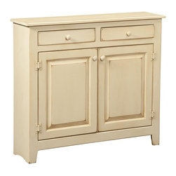 Chelsea Home - 2-Door Hannah Large Cabinet - Two top drawers. Wooden knobs. Tack slides on feet to prevent scuffing and easy mobility. Handcrafted and free-standing. Made from premium grade eastern white pine. Buttermilk finish. 41 in. W x 11 in. D x 36 in. H (50 lbs.). Made in U.S.A. No assembly requiredChelsea Home Furniture proudly offers American made heirloom quality furniture. What makes heirloom quality furniture? Its knowing how to turn a house into a home. Its clean lines, ingenuity and impeccable construction derived from solid woods, not veneers or printed finishes over composites or wood products, the best nature has to offer. Its creating memories. Its ensuring the furniture you buy today will still be the same 100 years from now! Every piece of furniture in our collection is built by expert furniture artisans with a standard of superiority that is unmatched by mass-produced composite materials imported from Asia or produced domestically. In addition, our craftsmen use tongue-in-groove construction and screws instead of nails during assembly and dovetailing, both painstaking techniques that are hard to come by in todays marketplace. So adorn your home with a piece of furniture that will be future history, investment that will last a lifetime. Screws, rather than nails or staples used to hand assemble furniture providing greater durability and strength.
