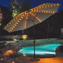 "Galtech 11-ft. Auto Tilt Patio Umbrella with LED Umbrella Lights - This is a great patio umbrella to have for garden parties or just relaxing in the summertime. An 11-foot shade keeps you cool and comfortable during the day, and built-in twinkling lights create romantic lighting in the evening. Shades are available in a variety of Sunbrella colors. Sunbrella is the absolute best you can buy for outdoor use. It comes with a 5-year warranty against fading. The aluminum pole features a classic Antique Bronze finish, and the auto tilt feature makes this umbrella easy to operate.The low voltage lighting package lets you enjoy your umbrella during the night with pleasant illumination. A switch on the housing operates the lights, and a 20-foot cord plugs in to any grounded outlet. The LED lights have been tested and will provide 15,000 hours of use. About SunbrellaSunbrella has been the leader in performance fabrics for over 45 years. Impeccable quality, sophisticated styling and best-in-class warranties prove the new generation of Sunbrella offers more possibilities than ever. Sunbrella fabrics are breathable and water-repellant. If kept dry, they will not support the growth of mildew as natural fibers will. Beautiful and durable, Sunbrella is a name you can trust in your outdoor furniture.Cleaning and Caring for SunbrellaRegular maintenance is the best way to keep your Sunbrella fabrics looking good and delay deep, vigorous cleaning. Brush off dirt before it becomes embedded in the fabrics, and wipe up spills as soon as they occur. For light cleaning, use a mild soap and water solution and a sponge, allowing your cleaning solution to soak into the fabric. Rinse thoroughly to remove all soap residue and allow fabric to air dry.Sunbrella fabrics have been tested to provide up to 98% UV protection, depending on depth of color. Whites and lighter colored fabrics provide less protection than darker fabrics. This protective factor is inherent to the product and will not diminish through use or exposure to the sun. Sunbrella furniture and umbrella fabrics have been awarded the ""Seal of Recommendation"" by the Skin Cancer Foundation, an international organization dedicated to the prevention of skin cancer. Beautiful and protective fabric is the hallmark of Sunbrella."