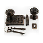 Ornamental Rim Lock Set with Knobs - This ornamental rim lock set features elaborate details and includes skeleton keys, keyhole, catch plate and beautifully designed door knobs.