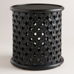 World Market - Black Tribal Carved Accent Table - Hand carved of mango wood by artisans in India, our Black Tribal Carved Accent Table lends an eclectic look to any space. In a trending color, its surface is perfect for a lamp, vase of flowers, plant or picture display.