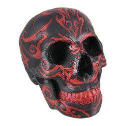 Zeckos - Black Human Skull Figure / Statue Red Tribal Graphics - This wickedly awesome skull figure/statue has a black enamel finish, with a symmetrically carved tribal tattoo pattern accented, by hand, in red enamel. Made of cold cast resin, the figure stands 6 inches tall, is 7 1/4 inches deep, and 5 inches wide. It makes a great Halloween decoration, and is a great gift for any skull lover.