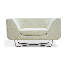 Bernard by Simon Pengelly for Modus - I love that this chair could have started out as a clunky block, and then it almost looks like someone carved its gentle curves like they would carve a bar of soap. To lessen the clunkiness factor even more, it floats on a stainless steel pedestal.