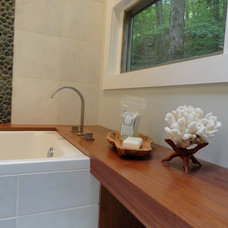 modern bathroom by Dichotomy Interiors