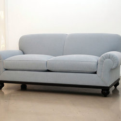 Classic Design - Sofas & Loveseats - This custom sofa features a tight back and loose seat cushions. The arms are rolled, giving the piece a quiet sophistication. The fabric is Linara Glacier by Romo, a beautiful light dusky blue, which contrasts perfectly with the dark wood base and turned legs.