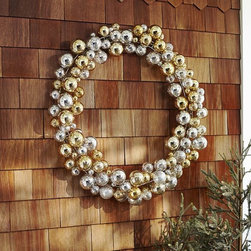 Outdoor Ornament Wreath - Metallic glass ornaments are the gold standard (pardon the pun) in holiday decor. This massive and beautiful ornament wreath from Pottery Barn is sure to catch the eyes of visitors and passers-by.