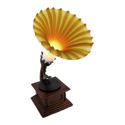 Zeckos - Antique Phonograph Accent Lamp with Amber Glass Shade - This phonograph accent lamp is a lovely addition to the home of music lovers and complements antique decor. It features a cold cast resin base with a wood finish and a flared bell shade made of amber glass. The lamp measures 12 3/4 inches tall, has a 6 1/2 inch diameter shade, and has a black 5 1/2 foot long power cord with a rocker on/off switch. It casts a warm glow in the room with a 15 watt (max) type T bulb (not included). This piece looks great on accent and end tables in any room, and makes a wonderful gift for friends and family.