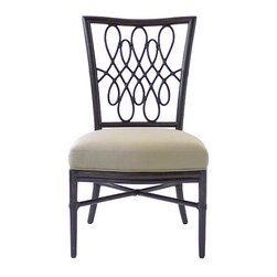 Barbara Barry Script Side Chair - The Barbara Barry Script Side Chair features a striking back detail that recalls the elegance and fluidity of Spencerian script. Playful and graceful, this calligraphic theme is a signature Barbara Barry design. Each piece is handcrafted by skilled McGuire artisans to create the design's dramatic, elegant curves in rattan. A Script arm chair is also available (M-268).