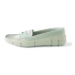 Frontgate - Women's Penny Front Loafer - Side vents and mesh lining ensure great comfort and breathability. Durable and flexible TPU outer shell. EVA insole and mesh top both have odor-resistant, antibacterial properties. Hand-sewn finishing joins rubber and mesh. Non-marking, non-slip lugged sole ensures stable footing. The classic loafer design is the perfect option for a day on the boat, at the beach, gardening, or at a pool party. Plus, it's made with Swims' signature rubber that is soft, flexible, and simply shrugs off water. It's the go-anywhere summer shoe.  .  .  .  .  . Water-resistant construction . Simply wipe clean or machine wash cold . Imported. Please Note: Women's shoe runs small; you may want to order one size up from your normal shoe size.