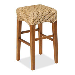 "Seagrass Backless Barstool - Classic coastal chic calls for these seagrass barstools. I'm seeing beadboard and a lot of natural light in the kitchen that these would go in.Dimensions: Medium — 14"" x 14"" x 26""H; Tall — 14"" x 14"" x 30""H. Available in honey weave and havana dark weave. handwoven natural fiber over a solid beech frame. Prices range from $129.00 – $149.00."