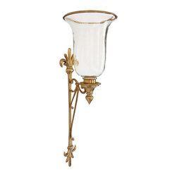 """Inviting Home - Hurricane Candle Sconce - brass hurricane candle sconce with scrolls and leaf motif; 7-1/2""""W x 8""""D x 22-1/2""""H; Elegant hurricane wall candle sconce is made from solid brass and has an antiqued finish. This hurricane sconce is designed with graceful scrolls and stylized leaf motif on the back. Hurricane candle sconce has a hand blown glass chimney with solid brass rim. Solid brass hand crafted hurricane candle sconce with hand blown glass chimney. This wall sconce has a soft antiqued finish."""