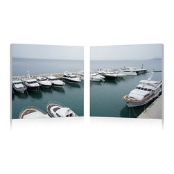 """Wholesale Interiors - Yacht Congregation Mounted Photography Print Diptych - The status symbol of the boating world, a group of yachts rest at dock atop an overcast sea. This photograph is printed on waterproof vinyl canvas before being mounted to two MDF wood frames. Made in China, the Yacht Congregation Modern Wall Art Set is ready to hang but requires hardware to hang on your wall. To clean, wipe with a dry cloth. Product dimension: 19.68""""W x 1""""D x 19.68""""H."""