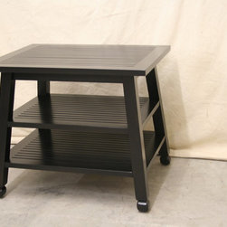 Occasional furnishings - A slatted ships table in an ebony finish. Photo by BSW Staff