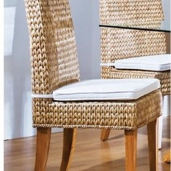 "Hospitality Rattan Sea Breeze Indoor Seagrass Side Chair with Cushion - Natural - You wouldn't think that combining simple materials around the standard form of the Hospitality Rattan Sea Breeze Indoor Seagrass Side Chair with Cushion - Natural would yield a result that's so hard to stop looking at. This contemporary side chair starts with a wooden frame that is then covered with hand-woven seagrass and supported by legs of solid, naturally finished hardwood. A high back with a slight curve at the top is the finishing touch on this pleasing, modern piece.About Hospitality Rattan Hospitality Rattan has been a leading manufacturer and distributor of contract quality rattan, wicker, and bamboo furnishings since 2000. The company's product lines have become dominant in the Casual Rattan, Wicker, and Outdoor Markets because of their quality construction, variety, and attractive design. Designed for buyers who appreciate upscale furniture with a tropical feel, Hospitality Rattan offers a range of indoor and outdoor collections featuring all-aluminum frames woven with Viro or Rehau synthetic wicker fiber that will not fade or crack when subjected to the elements. Hospitality Rattan furniture is manufactured to hospitality specifications and quality standards, which exceed the standards for residential use. Hospitality Rattan's Environmental Commitment Hospitality Rattan is continually looking for ways to limit their impact on the environment and is always trying to use the most environmentally friendly manufacturing techniques and materials possible. The company manufactures the highest quality furniture following sound and responsible environmental policies, with minimal impact on natural resources. Hospitality Rattan is also committed to achieving environmental best practices throughout its activity whenever this is practical and takes responsibility for the development and implementation of environmental best practices throughout all operations. Hospitality Rattan maintains a policy of continuous environmental improvement and therefore is a continuing work in progress. Hospitality Rattan's Environmentally Friendly Manufacturing Process All of Hospitality Rattan products are green. From its basic raw materials of rattan poles, peels, leather, bamboo, abaca, lampacanay, wood, leather strips, and boards, down to other materials like nails, staples, water-based adhesives, finishes, stains, glazes and packing materials, all have minimum impact to the environment and are safe, biodegradable, recycled, and mostly recyclable. Aside from this, the products have undergone an environmentally-friendly process that makes them """"greener."""" The company's rattan components are sourced from sustained-yield managed forests, which means the methods used to grow and harvest the rattan vines ensure the long-term life of the forest and protect the biodiversity of the forest's ecosystems. Hospitality Rattan is committed to buying and using all materials, from rattan and hardwood to finishing materials, from reputable and renewable suppliers and seeks appropriate evidence that suppliers are in compliance with this policy. Hospitality Rattan strives to use materials that are processed in an environmentally responsible manner, or consist of a high level of recycled material. Finishing materials and stains used in Hospitality Rattan's furniture products consist of 75% water-based solutions which evaporate upon application with reduced or Volatile Organic Compounds (VOCs). The furniture factories use water-based glues, stains, topcoats and other finishes on all of their products. The switch from traditional solvent-based processes to water-based processes involved consolidating several processes by the factories, resulting in an 85% reduction in VOC emissions."