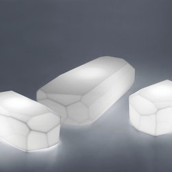 """Design Within Reach - Meteor with Light - What could be more appropriate for a product called """"Meteor"""" than to be made with what the designer calls """"collision-proof"""" plastic? Whether you use it as a table, seat, lamp or sculpture, the Meteor with Light (2006) is durable enough for indoor or outdoor use. """"Design is an uncontrolled muscle,"""" says Arik Levy, who is a designer, technician, artist, photographer and filmmaker. The Meteor evolved from his signature Rock pieces, which are an expression of his belief that """"life is a system of signs and symbols, where nothing is quite as it seems."""" Bulb (included): incandescent 20W/E27. UL listed. Made in Italy. For indoor or outdoor use, the Meteor can be used as a table, seat, lamp or sculpture. The Meteor is UV resistant and 100% recyclable. The black cord is 118"""" long."""
