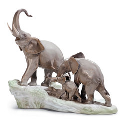 "Lladro Porcelain - Lladro Elephants Walking Figurine - Plus One Year Accidental Breakage Replacemen - ""Hand Made In Valencia Spain - Sculpted By: Fulgencio Garcia - Included with this sculpture is replacement insurance against accidental breakage. The replacement insurance is valid for one year from the date of purchase and covers 100% of the cost to replace this sculpture (shipping not included). However once the sculpture retires or is no longer being made, the breakage coverage ends as the piece can no longer be replaced. """