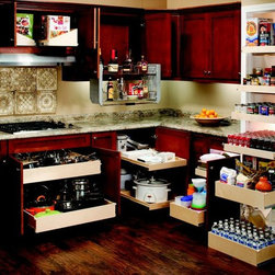 Kitchen Pull Out Shelves - ShelfGenie has a solution for every area of your kitchen, from your trash and recycling bins, to your corner cabinets, to your silverware drawers, to your pantry! Our pull out shelves hold up to 100 pounds and extend completely, providing you with easy access to all of your stored goods.