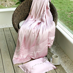 Classic Throw - King - Pebble - It may chase the chill of an autumn day passed outdoors among the changing colors of greenwood. Or it may welcome the cool breeze of the first blush of spring, enjoyed from a favorite garden chaise. The generously-sized Classic Throw is covered in charmeuse silk and filled with exquisite hand-stretched silk filling. Border stitching and a six-button design lend subtle yet sophisticated style.