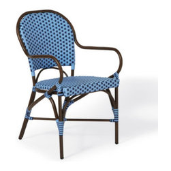 Grandin Road - Monet Cafe Outdoor Dining Outdoor Armchair - Outdoor furniture, crafted in classic French café style, designed to last longer than traditional rattan. Frame made from durable, all-weather aluminum. Seats are woven from two tones of resin strips that stand up to the elements. Dining Chairs offer taller, arched backs, for the perfect alfresco experience. With the Parisian bistro as our style muse, we've created an elegant, durable, and comfortable outdoor collection that recalls the traditional rattan furniture found in French sidewalk cafes. Each piece is crafted from resin rattan strips woven over an aluminum frame that resembles espresso-finished European bentwood. It's the perfect set for a backyard rendezvous, and it's made to stand the test of time. Outdoor furniture, crafted in classic French cafe style, designed to last longer than traditional rattan .  .  .  .