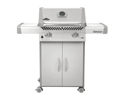 Napoleon Prestige P308 Gas Grill - The Napoleon Prestige P308 Gas Grill with folding side shelves is perfect for giving the chef a lot of power in limited space. This mobile unit stands on easy-roll locking casters that allow you to easily position your cooking area wherever you like and then set it firmly in place for safe grilling. If room is particularly scarce just fold down one or both of the side shelves which also feature integrated utensil holders for added convenience. The ventilated cabinet base is great for hiding away your natural gas or propane tank (both options are available) and above the doors you'll find ergonomically designed knobs that put you in total control of the 2 burners within. Without even opening the lift ease roll top lid you'll be able to monitor the heat inside simply by glancing at the temperature gauge right on the hood! Of course when it's time to open that lid and see the sizzling dishes within you'll be treated to a sight of exceptional engineering! The Napoleon Prestige features 2 burners capable of emitting up to 29 000 BTUs of heat evenly across 308 square inches of cooking space! That cooking space also happens to be made up of porcelainized cast iron which boasts the famed WAVE reversible cooking grids that are incredibly easy to clean. It's a remarkably balanced grill at an even more remarkable price. About Napoleon GrillsRising up from its humble beginnings in Barrie Ontario Canada Napoleon Gourmet Grills has become North America's largest privately owned manufacturer of top-of-the-line wood and gas fireplaces gourmet gas and charcoal grills waterfalls and outdoor living products. It all started 1976 when Wolfgang Schroeter started manufacturing steel railings. His designs proved to be a great success and soon enough he was producing an original stove with a solid cast iron two-door design in a 1 000 square foot facility. And over the past 30 years his company Wolf Steel Ltd's dedication to innovative patented technology has lead to the exclusive infrared grilling experience and two new departments: Napoleon Fireplaces and of course Napleon Gourmet Grills. Today this company operates with over 500 000 square feet and over four-hundred hard workers in its employ.