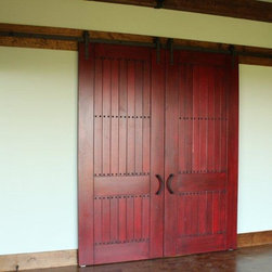 """Sliding Barn Doors - These doors are our newly designed sliding barn doors. We designed, built, distressed and finished these doors. The finish on these doors is Indian Red with a Crackled Glaze. These doors were customized with our 1"""" Bronze Finished Clevos."""