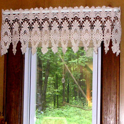 Pictures from Our Customers. - Our customer Jacque from Tyler Hill PA sent us this picture of the Victoria Macrame pattern which she used in a mountain cabin.  She obviously did not want to hide the view of the forest.  The Valance is used to hide the pull shade that has been installed behind it.