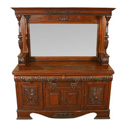 Antiques - Large Antique Walnut Mirrorback Sideboard - This gorgeous antique walnut sideboard has a large bevelled edge mirror flanked by large turned and carved columns with candle shelves. The drawers have rounded and carved fronts with huge solid ring pulls, dovetail joinery, and work very smoothly in spite of not being on runners. The molded crown features a rounded and accent carved frieze. The side cabinet doors have a large raised carving and uniquely shaped drop pulls while the center cabinet doors are deeply paneled. The sides of the piece are beautifully paneled as well. The lower right cabinet features a cellaret*. This piece rests on large bevelled bracket feet and the gently curved skirt has an accent carving. This stunning sideboard can easily be the centerpiece of any dining room. Condition:The mirror is in fine shape with only one dime-size flaw on the lower left and several tiny flaws around the edges that confirm authentic originality. The surface has a separation from the right side and some age appropriate staining. The lock hardware is missing from the inside of the center door, hidden when the door is closed. The edge of the bevelled surface is nicked near the left side. The center drawer has had the original felt removed and the glue residue is still present. Overall this piece is in outstanding condition considering the age (circa 1900). Other Dimensions: (In inches): Surface  39.5H x 69.5W x 21.25D. Mirror  25.5H x 51.5W. Top Left Drawer  3H x 30.5W x 16.25D. Top Right Drawer  3H x 30.5W x 16.25D. Center Drawer  4.25H x 25W x 16D. Left Cabinet Top Shelf  9H x 20W x 19.5D. Left Cabinet Bottom Shelf  13H x 18W x 19.5D. Center Cabinet  16.25H x 27.5W x 19.75D. Right Cabinet Top Shelf  8H x 19.75W x 19D. Cellaret Sliding Drawer  4.25H x 11W x 10D.