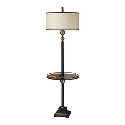 Uttermost Revolution End Table Floor Lamp - Rustic black with coffee bronze metal accents and a tempered glass tray. Rustic black finish with coffee bronze metal accents and a tempered glass tray. The round drum shade is an off-white linen fabric with rustic black metal trim.