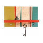 "Pig and Fish - Geometric Wall-Mount Shelf With Key Hooks - This artfully designed piece can stand alone as part of your wall decor as our specialty is blending art with function.  The geometric background pattern is hand painted in diagonal shapes with the vibrant colors of chartreuse, teal, gray, and reddish orange to compliment the strips of natural wood.  The natural wood shelf is edged in the reddish orange and is nicely framed by the geometric background.  The small shelf is 11 ¾"" L x 3 ½"" D and was designed as the perfect place for your phone, wallet or glasses.  The 4 hooks below are ideal for hanging your keys, making this shelf an artful and welcome addition to your entry space.   Now, just be sure to hang your keys up so they don't end up in the wash - again!"