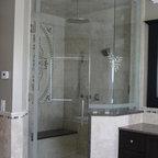 Frameless Shower Enclosure - fully frameless shower enclosure with transom.  glass has been sandblasted along perimeter.