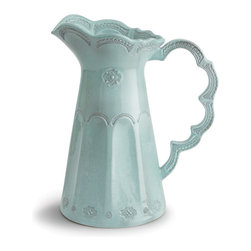 Merletto Aqua Scalloped Pitcher - An airy scalloped handle complicates the silhouette of the tall, lean Merletto Aqua Scalloped Pitcher, giving a natural elegance to its profile that will gracefully preside over the table � though the narrower mouth and slightly wider base of this tapered ceramic ewer lend themselves well to displaying long-stemmed wildflowers.  The European porcelain is stamped with vintage lace patterns and glazed in a soft, limpid aqua blue.