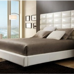 Baylor Upholstered Platform Bed - White Bonded Leather - A modern beauty, the Baylor Upholstered Platform Bed - White Bonded Leather features a regal, high-profile tufted headboard upholstered in bonded white leather. Square tapered legs and a glossy black finish complete the urban vibe. This bed requires a box spring, which is not included. Comes in select size options.Bed Dimensions:Full/Double: 82.7L x 59.5W x 61.8H inchesQueen: 88.6L x 65W x 61.8H inchesKing: 88.6L x 82.7W x 61.8H inchesAbout Homelegance, Inc.Homelegance takes pride in offering only the highest quality home furnishings that incorporate innovative design at the best value. From dining sets to mirrors, sofas, and accessories, Homelegance strives to provide customers with a wide breadth and depth of selection as well as the most complete and satisfying service available for their category. Homelegance distribution centers are conveniently located throughout the United States and Canada.