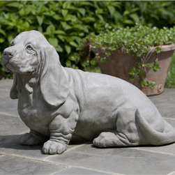 Campania International - Campania International Chandler The Basset Hound Cast Stone Garden Statue - A-37 - Shop for Statues and Sculptures from Hayneedle.com! A beautiful tribute to a best friend lost or just a lovely accent for your garden or walk the Campania International Chandler The Basset Hound Cast Stone Garden Statue has a durable cast stone construction to last for years. Available in your choice of patina finishes this statue is proudly made in the USA.About Campania InternationalEstablished in 1984 Campania International's reputation has been built on quality original products and service. Originally selling terra cotta planters Campania soon began to research and develop the design and manufacture of cast stone garden planters and ornaments. Campania is also an importer and wholesaler of garden products including polyethylene terra cotta glazed pottery cast iron and fiberglass planters as well as classic garden structures fountains and cast resin statuary.Campania Cast Stone: The ProcessThe creation of Campania's cast stone pieces begins and ends by hand. From the creation of an original design making of a mold pouring the cast stone application of the patina to the final packing of an order the process is both technical and artistic. As many as 30 pairs of hands are involved in the creation of each Campania piece in a labor intensive 15 step process.The process begins either with the creation of an original copyrighted design by Campania's artisans or an antique original. Antique originals will often require some restoration work which is also done in-house by expert craftsmen. Campania's mold making department will then begin a multi-step process to create a production mold which will properly replicate the detail and texture of the original piece. Depending on its size and complexity a mold can take as long as three months to complete. Campania creates in excess of 700 molds per year.After a mold is completed it is moved to the production area where 