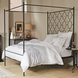 "Ellipse Metal Canopy Bed | west elm - Regency meets garden gate meets canopy in this fabulous bed. Add some geometry and eliminate the problem of what to hang on the wall behind your bed with this geometric modern bed.Powder-coated metal with anthracite finish.Sturdy metal frame has an open and airy construction.Canopy bed adds drama and presence to the bedroom.16"" side rail height creates extra room for underbed storage.Assembly required.• Twin: 40.5""w x 77.75""d x 82""h.• Full: 56""w x 77.75""d x 82""h.• Queen: 62.5""w x 82.75""d x 82""h• King: 78.5""w x 82.75""d x 82""hPrice is for Queen size; prices vary by bed size"