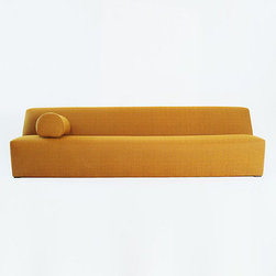 Kevin Walz Sofa - This sofa is designed by one of my most favorite designers, Kevin Walz. I love its asymmetry and simplicity. It would be my pick if I wanted to have a very modern sofa in my living room. Très chic!